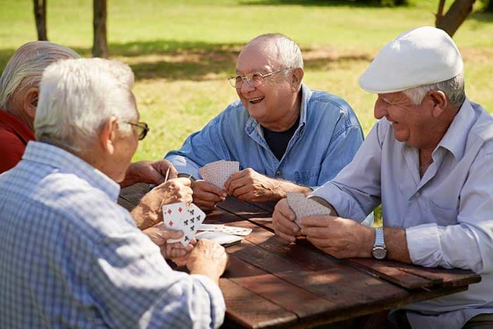Friends playing cards at Canoe Brook Broken Arrow